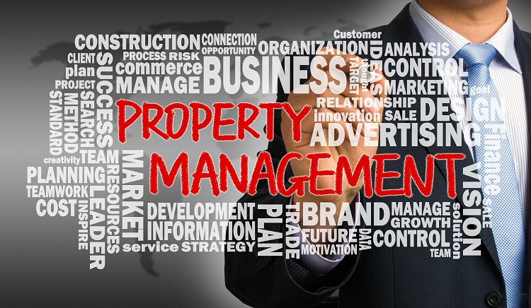 property management concept with related word cloud handwritten by businessman